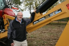 Tim Norris with Soil-Max Gold Digger drainage plow